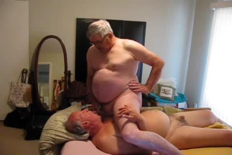 Two older guys Playing In bed