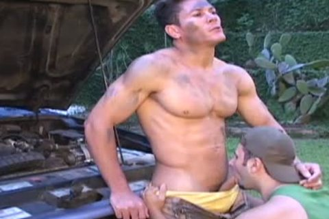 Muscle Ripped Mechanic gets poked